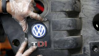 Volkswagen logo and technician
