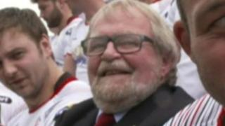 Graffin Parke, pictured in suit, with the Ulster Rugby team in 2017