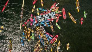 Aerial photo of kayakers protesting the dam