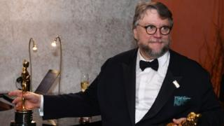 Best Director and Best Film laureate Mexican director Guillermo del Toro stands at the engraving station as he attends the 90th Annual Academy Awards Governors Ball at the Hollywood ^ Highland Center on March 4, 2018, in Hollywood, California.