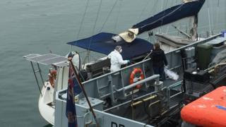Drugs officers searching the yacht
