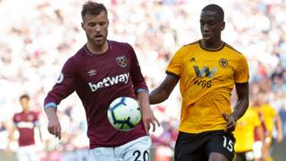 Andriy Yarmolenko of West Ham United and Willy Boly of Wolverhampton Wanderers