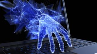 Graphic of hand coming through a laptop