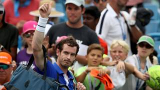 Andy Murray waves goodbye to the crowd after defeat to Richard Gasquet
