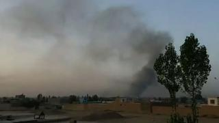 Smoke rises into the air after Taliban militants launched an attack on the Afghan provincial capital Ghazni