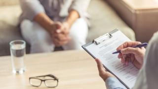 Doctor talks to patient