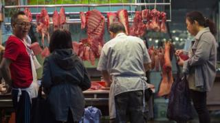 Patrons buy meat from a butcher stall in Hong Kong, China, 22 March 2017.