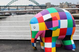 An Elmer sculpture with the Tyne Bridge in the background