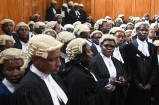 Some of the 145 newly admitted advocates, wait inside the Supreme Court to pick-up their 'certificates of practise' at the Supreme Courts of Kenya