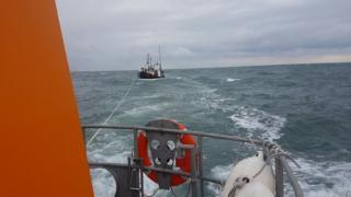 Trawler towed