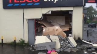 Tesco Express building showing blown up cash machine