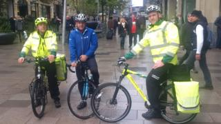 WAST Cycle Response Unit members Lawrence Evans and Tom Carter supported by John Wheat, Newport Social Cycling