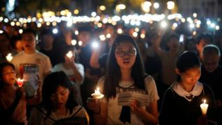 Thousands of people take part in a candlelight vigil to mark the 30th anniversary