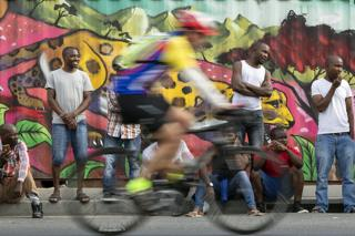 in_pictures People watching a cyclist riding through Masiphumelele near Cape Town, South Africa - Sunday 8 March 2020