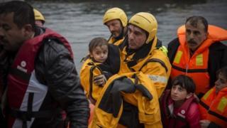 A Spanish volunteer helps migrants in Greece