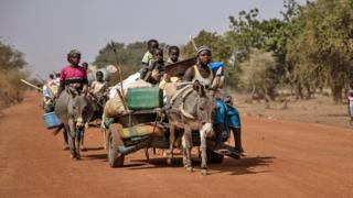 People on carts pulled by donkeys on the road from Barsalogho to Kaya in Burkina Fasao - Monday 27 January 020