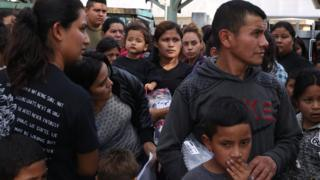 Undocumented immigrant families are released from detention at a bus depot in McAllen, Texas