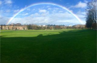 Picture taken from Bruntsfield Links in Edinburgh showing a rainbow going from the castle to the crags