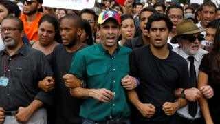 Henrique Capriles during tribute to student killed during protests in Caracas on 26 April