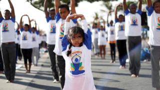 A young girl performs yoga exercises in Durban, South Africa