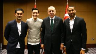 lkay Gundogan and Mesut Ozil, along with Everton's Cenk Tosun, pose with the Turkish president