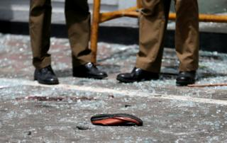 A shoe of a victim is seen on the floor after an explosion in the city of Colombo, Sri Lanka.