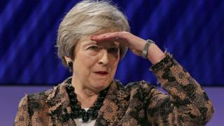 British Prime Minister Theresa May gestures as she asks a question at the annual Confederation of British Industry Conference (CBI) in London on November 19, 2018.