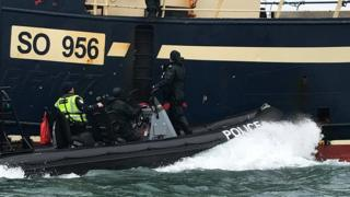 A fishing boat being raided