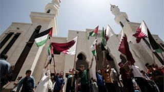 أعلام قطر وفلسطين