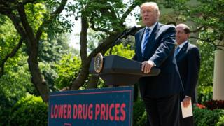 US President Donald Trump delivers remarks with Health and Human Services Secretary Alex Azar (R) on reducing drug costs in the Rose Garden at the White House in Washington, DC, on May 11, 2018.