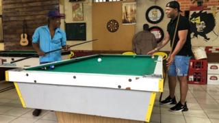 Ed and his dad play pool together