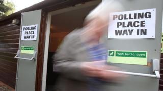A voter leaves Broomhouse Community Hall polling station in Glasgow after casting their vote for the local council elections.