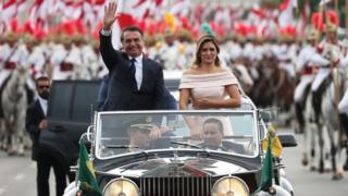 Jair Bolsonaro waves as he drives past in Brasilia, Brazil, January 1, 2019