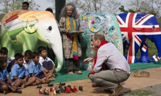 Prince William and wife The Duchess of Cambridge speak to kids from a local village in India