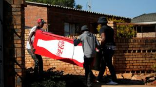 People stealing a fridge near Pretoria, South Africa