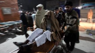 A man being rushed to hospital in Peshawar after the quake