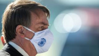 Brazilian President Jair Bolsonaro wears a face mask