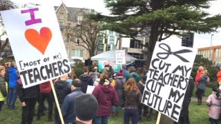 Parents and pupils hold protest over planned education funding cuts in Conwy county