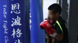 Child training with boxing bag at Enbo Fight Club