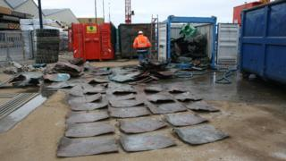 Copper plates laid out from ship