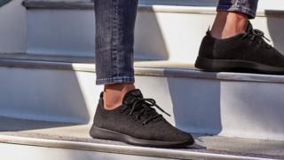 Someone wearing Allbirds Wool Runners shoes