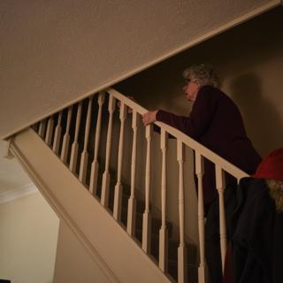 Woman going up stairs