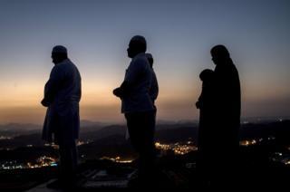 Muslim Hajj pilgrims pray at the Jabal al-Nour (al-Noor mountain) during the annual Hajj pilgrimage in Mecca, Saudi Arabia, 15 August 2018.