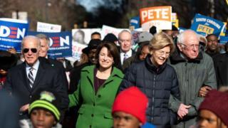 Democratic presidential candidates, former Vice President Joe Biden, left, Amy Klobuchar , Elizabeth Warren , Bernie Sanders