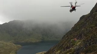 Search and rescue teams recover a man's body from Cader Idris