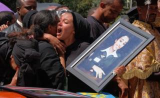 in_pictures A woman cries over the coffin of her loved one during a memorial service for the Ethiopian passengers and crew who perished in the Ethiopian Airways ET302 crash - March 2019