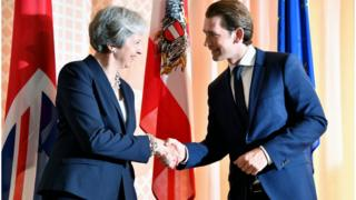 Austrian Chancellor Sebastian Kurz welcomes Theresa May for the opening of Salzburg's festival for opera, drama and concerts on July 27, 2018