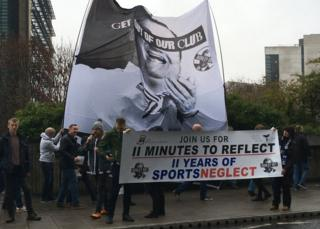 Newcastle United fans protesting outside St James' Park