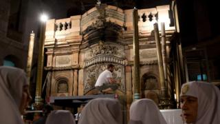 "Christian nuns watch as a team of experts begin renovation of Jesus"" tomb"