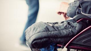 Close-up of a man sitting in a wheelchair